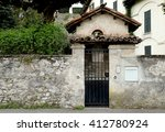 in front of vintage stone house | Shutterstock . vector #412780924