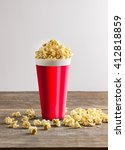 popcorn in bucket on wooden... | Shutterstock . vector #412818859