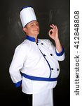 Small photo of Portrait of chef and hand doing gesture is all right