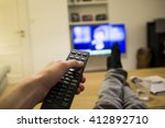 a person watching the news on... | Shutterstock . vector #412892710