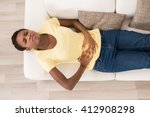 young african woman lying on... | Shutterstock . vector #412908298