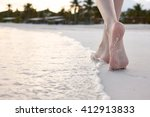 Woman Walking On A Beach