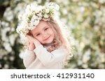 smiling kid girl posing with...   Shutterstock . vector #412931140