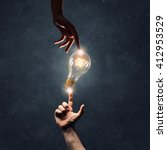 hand pointing light bulb