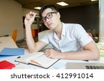 young asian student studying...   Shutterstock . vector #412991014