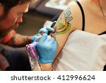 master tattoo artist with a... | Shutterstock . vector #412996624