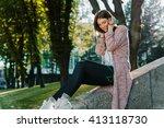 teen girl sitting on a rock... | Shutterstock . vector #413118730