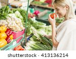 young woman baying vegetable on ...   Shutterstock . vector #413136214