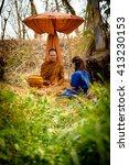 buddhist monks meditating in... | Shutterstock . vector #413230153