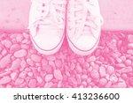 female white sneakers standing...   Shutterstock . vector #413236600