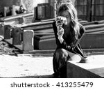sad woman holding bunch of... | Shutterstock . vector #413255479