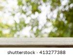 wood table top on bokeh... | Shutterstock . vector #413277388