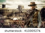 Gunfighter of the wild west at the train station. - stock photo