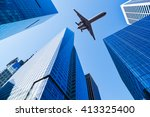airplane over office buildings... | Shutterstock . vector #413325400