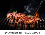 beef steaks on the grill with... | Shutterstock . vector #413328976