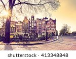 Stock photo beautiful amsterdam sunset typical old dutch houses on the bridge and canals in spring netherlands 413348848