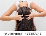 women itching scalp | Shutterstock . vector #413357143