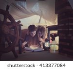 two young children are reading... | Shutterstock . vector #413377084