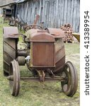 Small photo of VILNIUS, LITHUANIA -APRIL 03, 2016: Retro rusty agrarian American tractor Fordson brand in the museum of agriculture. The museum is located in the historical Vilnius area - Pilaite