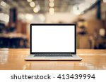 laptop with blank screen on... | Shutterstock . vector #413439994