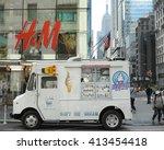 white ice cream truck under h m ... | Shutterstock . vector #413454418