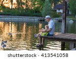 Dad And Daughter Feed The Duck...