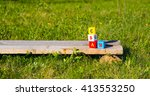 letters cubes in grass | Shutterstock . vector #413553250
