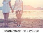 happy friends holding hands in... | Shutterstock . vector #413593210