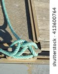 Small photo of Closeup on rope for mooring a vessel is adhered to a pier