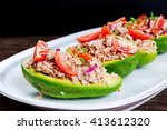 avocado boats stuffed with tuna ... | Shutterstock . vector #413612320
