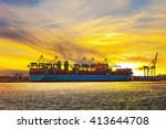 container ship at sunset in... | Shutterstock . vector #413644708