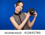 young girl in a shirt looking... | Shutterstock . vector #413692780