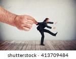 a big male's hand is pulling a... | Shutterstock . vector #413709484