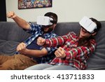 Stock photo a young man and woman in casual clothes playing racing game using virtual reality headset 413711833