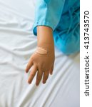 Small photo of Child hand with an adhesive bandage.