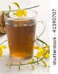 Small photo of Herbal tea.Infusion in a glass cup.Retama sphaerocarpa.Naturopathy.Selective focus.