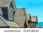 roofs of a modern houses in... | Shutterstock . vector #413918224