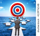 Small photo of Businessman goes through obstacles to goal. Man in suit standing on arrow. Ahead of target