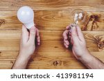 man hands with glow lamp and... | Shutterstock . vector #413981194