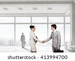 business partners handshake | Shutterstock . vector #413994700
