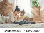 Small photo of Happy loving family. Mother and her daughter child girl playing and hugging.