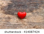 Small Red Heart On Wooden Table