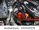 Small photo of Moscow, Russia - April 25, 2015: classic chopper motorcycle with brake lever in the shape of brass knuckles and bodywork with aerography, fire sculls and celtic pattern