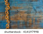 pretzels hanging on a rope on... | Shutterstock . vector #414197998