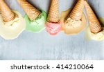 Stock photo colorful ice cream cones of different flavors melting scoops top view copy space steel metal 414210064
