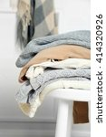 pile of woolen clothes on white ... | Shutterstock . vector #414320926