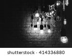 incandescent lamps on a brick... | Shutterstock . vector #414336880