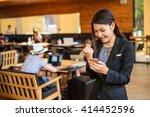 woman watching her smart phone... | Shutterstock . vector #414452596