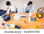 positive colleagues working... | Shutterstock . vector #414454750