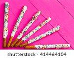 Six Long Pretzel Sticks Coated...
